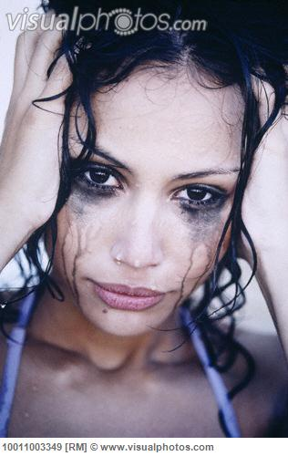 Crying Young Woman with Running Mascara