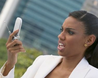 black-woman-looking-at-cell-phone-bossip-com-378x302