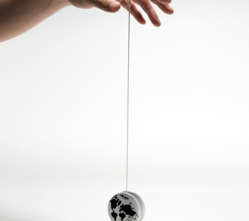 man playing with a yoyo globe