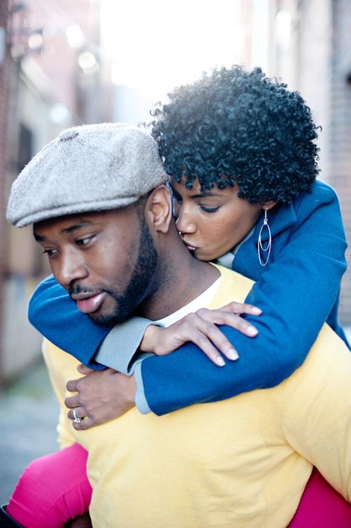 black-woman-kissing-man-on-neck