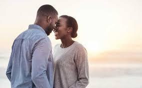 Black couple kissing